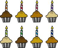 Cupcakes with candles Royalty Free Stock Photos