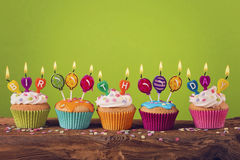 Cupcakes with candles Royalty Free Stock Photo