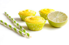 Cupcakes with cheese cream, lime, drinking straws Royalty Free Stock Image