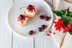 Cupcakes with cherries and flowers Royalty Free Stock Photo