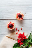 Cupcakes with cherries and flowers Stock Photography