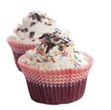 Cupcakes with chocolate chips and colored sprinkles Stock Images