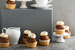 Cupcakes with chocolate frosting and little donuts Stock Photos