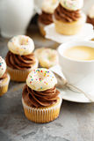 Cupcakes with chocolate frosting and little donuts Stock Images
