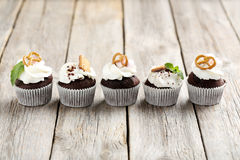 Cupcakes. Chocolate cupcakes on a grey wooden table Stock Images