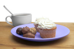 Cupcakes with chocolate on the plate Stock Photography