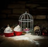 Cupcakes,Christmas candle and Christmas decorations on wooden ba stock image