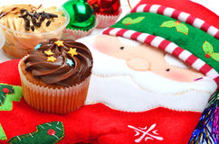 Cupcakes on christmas decoration background Royalty Free Stock Photo