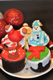 Cupcakes with Christmas Decorations. Christmas cupcakes with Santa, Snowman and Reindeer frosting decorations Royalty Free Stock Photos