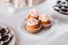 Cupcakes closeup at the banquet table Royalty Free Stock Photo