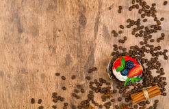 Cupcakes with coffee beans and cinnamon on a wooden background. Stock Images
