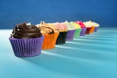 Cupcakes colorful cream muffin arrangement Stock Images