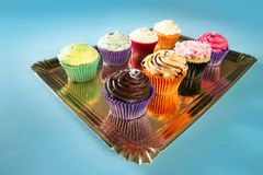 Cupcakes colorful cream muffin arrangement Stock Image