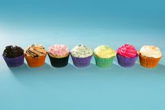 Cupcakes colorful cream muffin arrangement Stock Photo