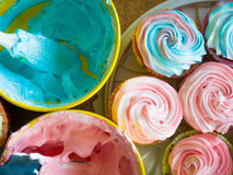 Cupcakes colorful cream muffin arrangement in golden mirror tray The concept of homemade baking and hospitality at home Stock Image