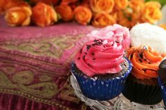 Cupcakes colorful muffin pink orange cream vintage Stock Images