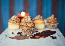 Cupcakes on the coloured background Royalty Free Stock Images