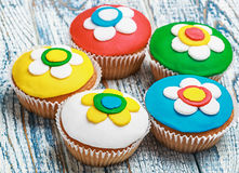 Cupcakes covered with mastic Stock Photos