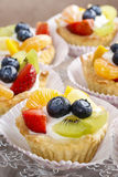 Cupcakes with cram and fresh fruits Royalty Free Stock Images