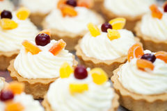 Cupcakes with cranberry Stock Images