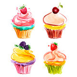 Cupcakes with cream and berries Stock Images