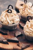 Cupcakes with cream and chocolate close-up, selective focus stock images