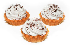 Cupcakes. With cream and chocolate on white background Stock Images