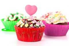Cupcakes with cream frosting and a red heart Stock Photo