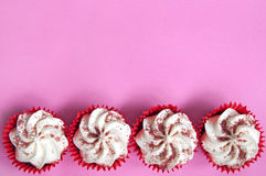 Cupcakes. Cream cupcakes over a pink background Stock Photo