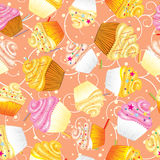 Cupcakes with cream Seamless vector background Royalty Free Stock Photo
