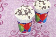 Cupcakes with cream Stock Image