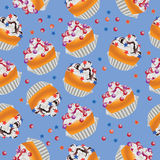 Cupcakes with cream, stars and dragee. Royalty Free Stock Photos