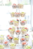 Cupcakes with cupcake stand Royalty Free Stock Image