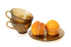 Cupcakes and cups isolated against white background Stock Photography