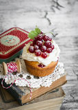 Cupcakes with curd cream and red currants Stock Images