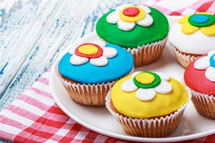 Cupcakes decorated with colorful mastic Stock Image