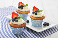 Cupcakes decorated with fresh berries Stock Image