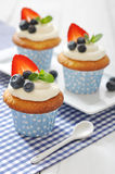 Cupcakes decorated with fresh berries Stock Photography