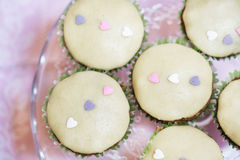Cupcakes decorated with marzipan hearts for Valentine Royalty Free Stock Photo