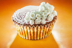 Cupcakes decorated with roses Royalty Free Stock Image