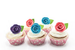 Cupcakes decorated with roses on a white background Royalty Free Stock Photos