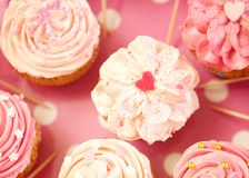 Cupcakes decorated with sprinkles and frosting Royalty Free Stock Image