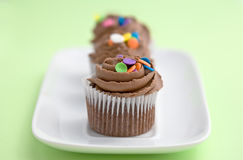Cupcakes in een rij Royalty-vrije Stock Fotografie