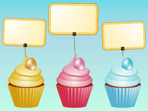 Cupcakes with eggs and blank labels Royalty Free Stock Photos