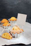 Cupcakes with empty tag on the wooden table Stock Photo