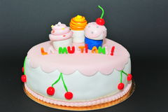 Cupcakes figurines fondant birthday cake Royalty Free Stock Photo