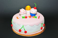 Cupcakes figurines fondant birthday cake. Beautifully crafted fondant cake for a special birthday stock image