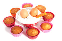 Cupcakes with flour and eggs Stock Image