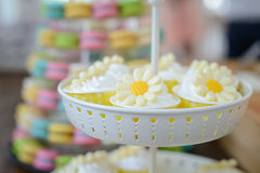 Cupcakes with flower decorated on stand Stock Photo