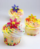 Cupcakes with Flower and Sprinkles Decorations Stock Photo